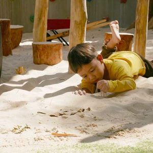 Child plays in the sand at British Early Years Centre International kindergarten in Bangok